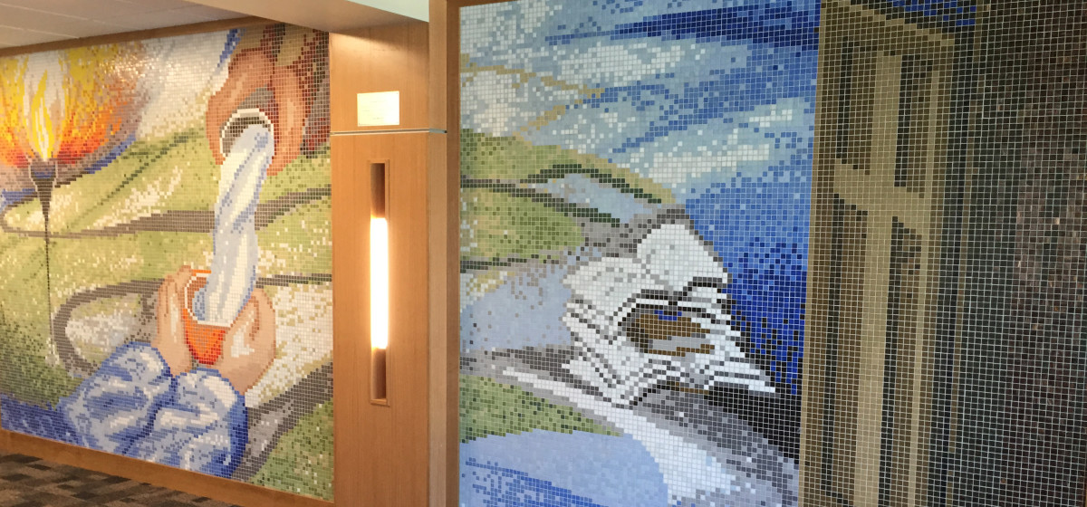 blue green red mosaic wall highschool entryway