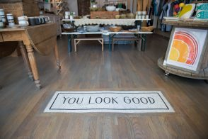 """hand-cut 3/4"""" vitreous glass mosaic sign in boutique entryway"""