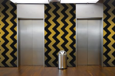 Yellow Repeating Contemporary Geometric Mosaic installation by Artaic